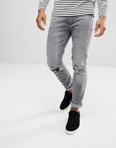 Серые выбеленные джинсы скинни с рваными коленями River Island - Серый
