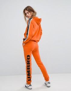 Спортивные брюки с логотипом на штанине Umbro - Оранжевый