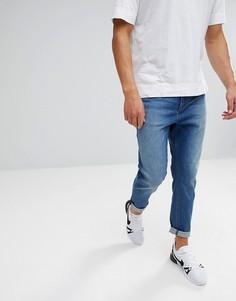 Умеренно выбеленные суженные книзу джинсы ASOS - Синий