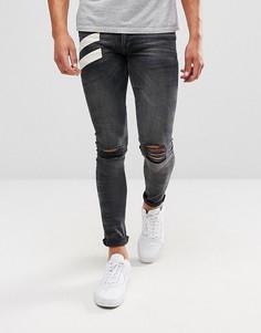 Черные винтажные джинсы скинни с белым принтом ASOS - Черный