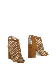Полусапоги и высокие ботинки Giannico