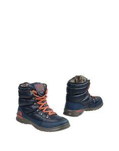 Полусапоги и высокие ботинки The North Face