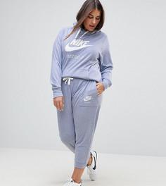 Серые трикотажные брюки для занятий спортом Nike Plus - Серый
