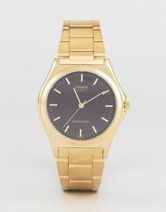 Часы с ремешком из нержавеющей стали Casio MTP1130N-1A - Золотой