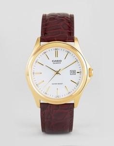 Аналоговые часы с коричневым кожаным ремешком Casio MTP1183Q-7A - Коричневый