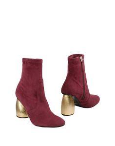 Полусапоги и высокие ботинки Carven