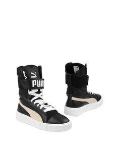 Полусапоги и высокие ботинки Puma