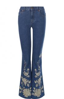 Расклешенные джинсы с потертостями и контрастной отделкой Gucci