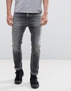 Зауженные рваные джинсы с заплатками и эффектом кислотной стирки Calvin Klein - Черный
