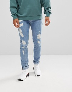 Выбеленные рваные джинсы скинни с шевронным принтом ASOS - Синий