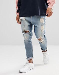 Выбеленные голубые рваные джинсы заниженного кроя ASOS - Синий