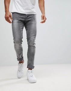 Черные супероблегающие джинсы с эффектом кислотной стирки New Look - Черный