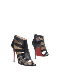 Полусапоги и высокие ботинки Christian Louboutin