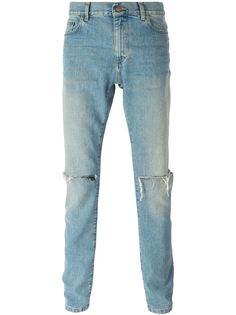 джинсы кроя слим с рваными коленями Saint Laurent