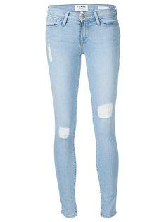 джинсы с рваными деталями Frame Denim