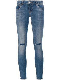 джинсы скинни с рваными деталями Anine Bing