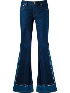 расклешенные джинсы с бахромой Amapô