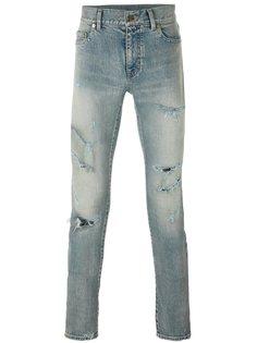 джинсы скинни с рваными деталями Saint Laurent