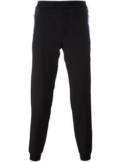 спортивные брюки с кожаными вставками  Les Hommes
