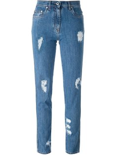 джинсы с рваными деталями   Moschino