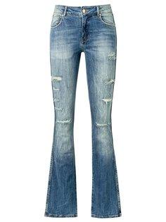 расклешенные джинсы с потертой отделкой Amapô