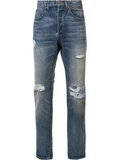 джинсы с рваными деталями 321