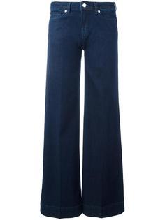 расклешенные джинсы с вышивкой Love Moschino