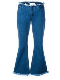 расклешенные джинсы с необработанными краями Marquesalmeida