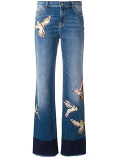 джинсы с заплатками в виде птиц Red Valentino