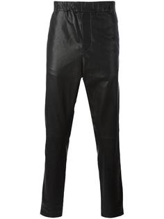 кожаные зауженные брюки Ann Demeulemeester Grise