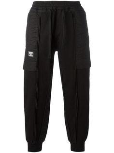 спортивные брюки с эффектом вывернутых наизнанку KTZ