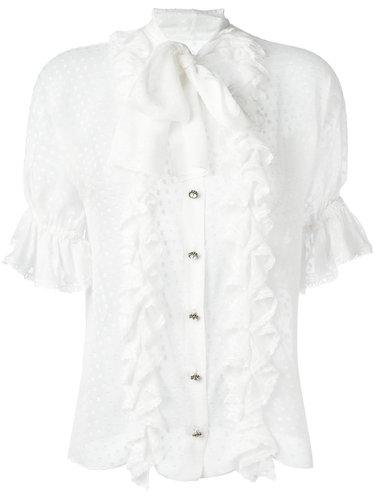 e2cb23a5fe9 Белая блузка из микса шелка и хлопка в горох с оборками от Dolce   Gabbana.  Воротник-стойка с бантом спереди