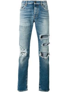 джинсы с высокой талией и рваными деталями Saint Laurent