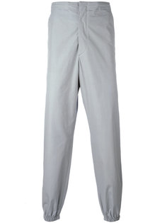 брюки с присборенными брючинами Jil Sander