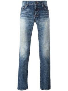 джинсы с потертостями Saint Laurent