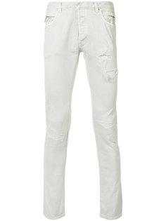 узкие джинсы с протертыми деталями Balmain