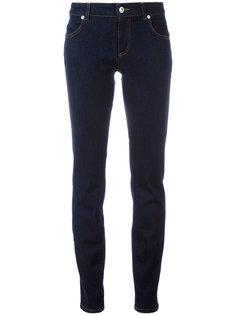 джинсы скинни с львиной головой  Versus