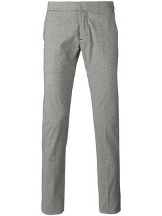 брюки с узором в ломаную клетку Andrea Pompilio