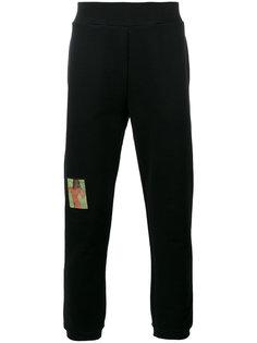 брюки-джоггеры Christopher Kane