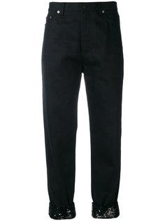 джинсы с кружевным подолом Saint Laurent