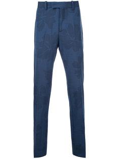 классические брюки с растительным принтом Oamc