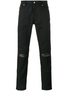 джинсы с заклепками на коленях Saint Laurent