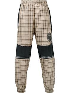 клетчатые брюки с фирменной нашивкой Astrid Andersen