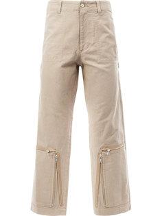 брюки с молниями Undercover