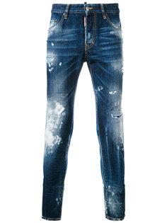 зауженные джинсы с эффектом разбрызганной краски Dsquared2