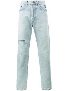 выцветшие джинсы с рваными деталями Saint Laurent