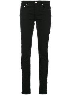 узкие джинсы с заклепками в виде звезд Givenchy