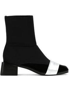 asymmetric boots Gloria Coelho