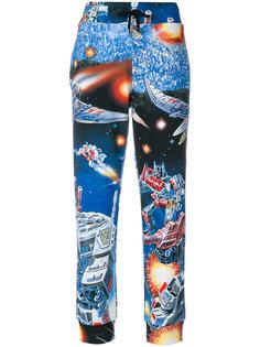 спортивные брюки с космическим принтом Moschino