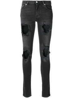 джинсы с потертой отделкой Givenchy